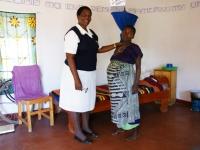 Zwangere vrouw met verzorgende